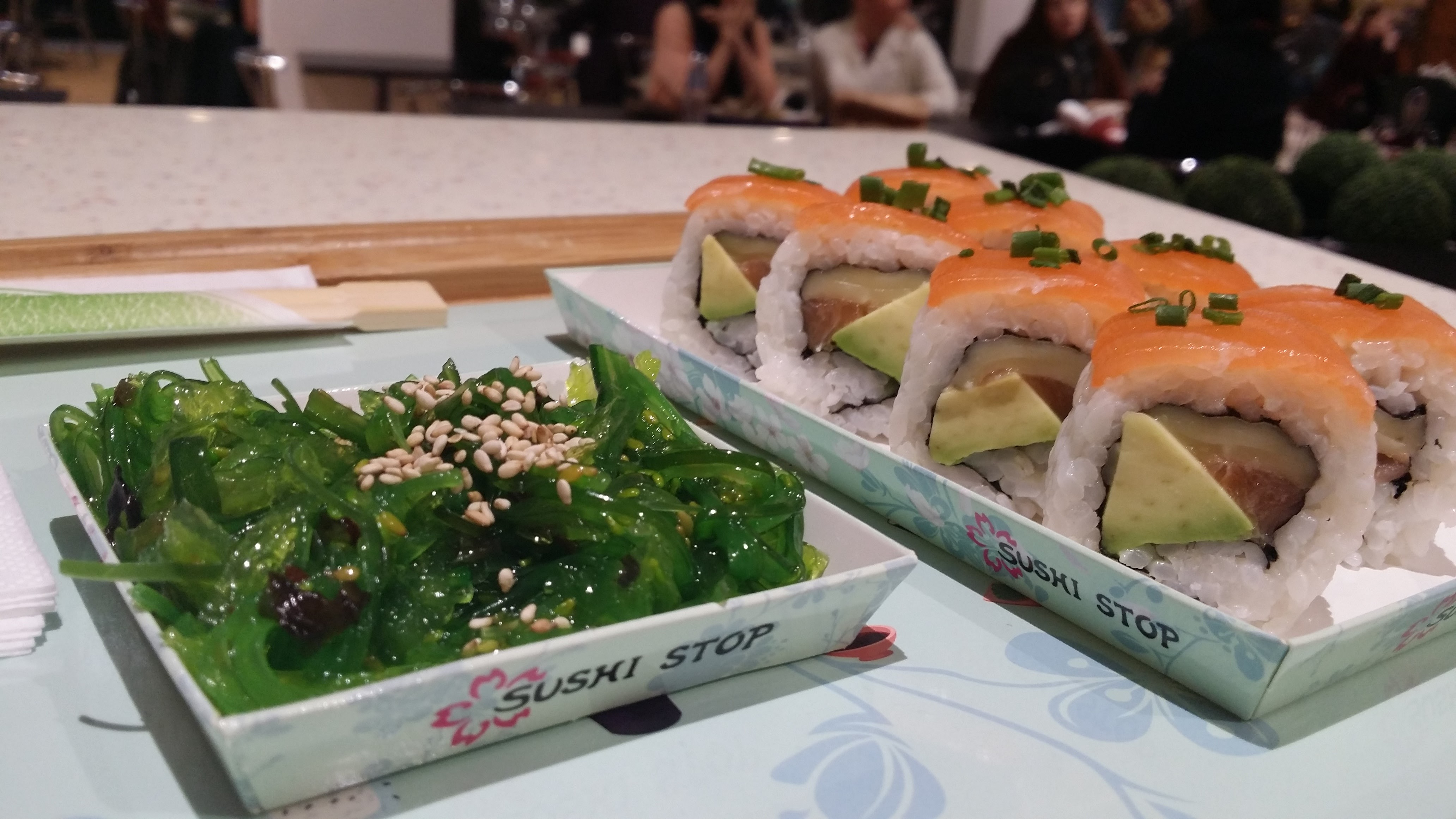 Sushi roll and salad