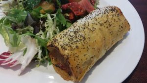 Sausage roll and salad